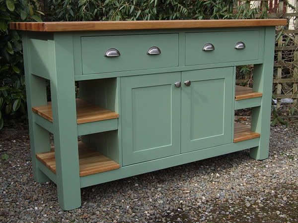 freestanding kitchen island with deep side drawers over a double cupboard & end shelves