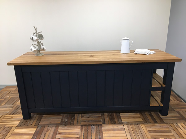 long freestanding kitchen island with planked oak worktop