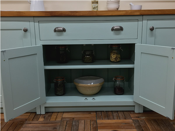 bespoke fitted kitchen double base cabinet with adjustable shelf.