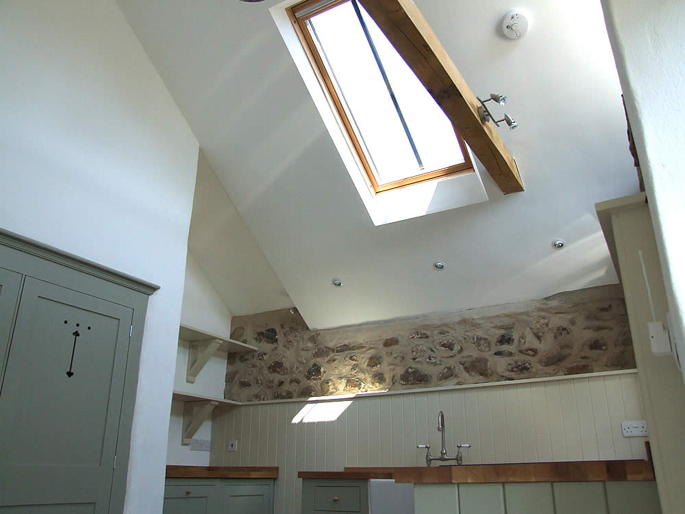 Bespoke painted Shaker kitchen in a West Wales barn cornversion with a double height ceiling