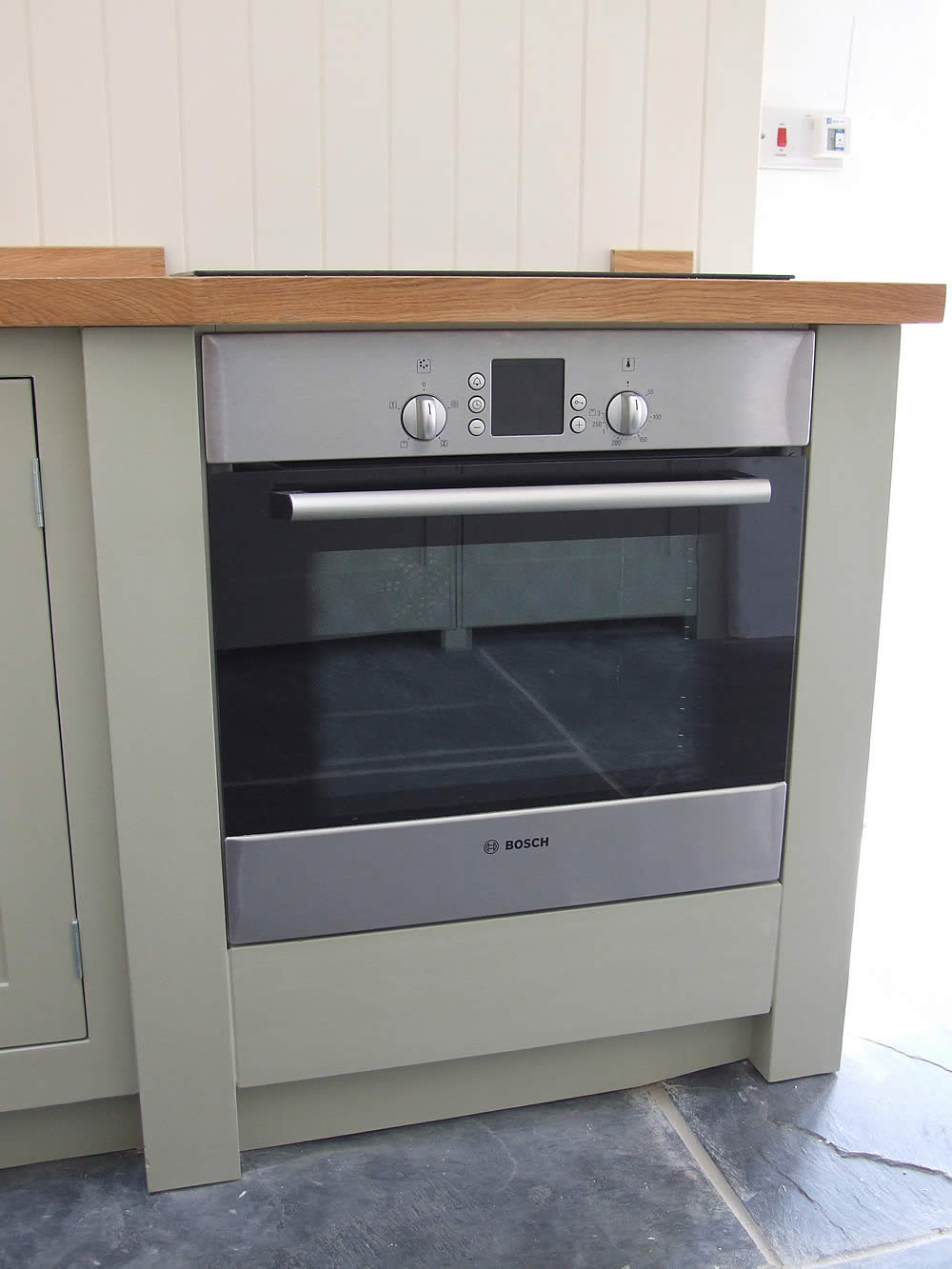Painted Shaker kitchen cupboard containing an integrated oven